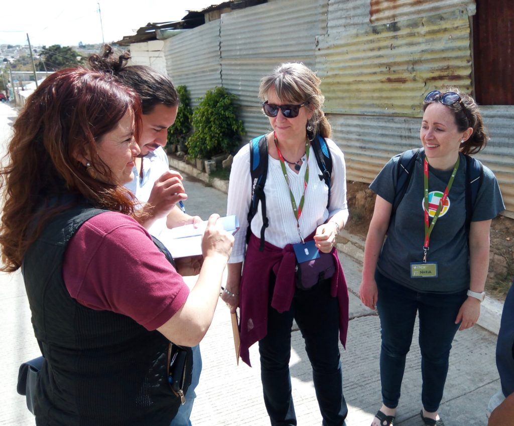 Using field papers to verify building locations on OSM in Ciudad Satélite, Mizco, Guatemala. From left to right: PADF staff member Claudia Chajon, community volunteer Jorge Cano, AGS President Marie Price, and GWU Professor Nuala Cowan