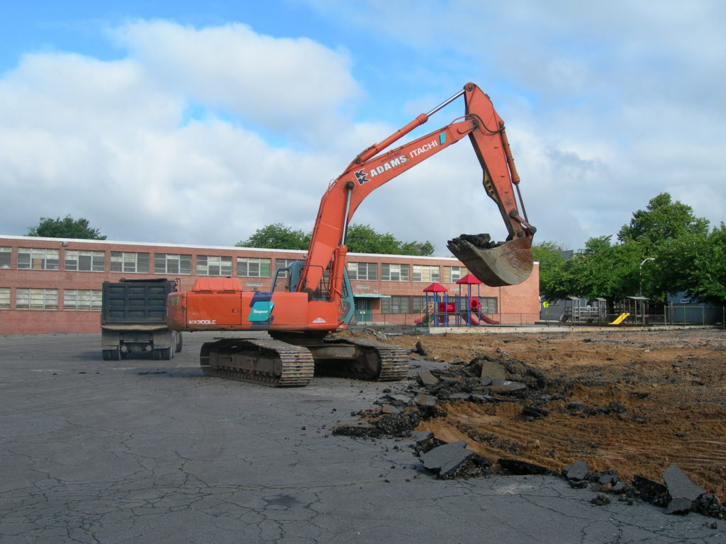 Fig. 4 – Franklin Square Elementary School, Baltimore, MD, June 28, 2006. Photograph by Guy Hager. Heavy equipment is employed to break up the asphalt and transport it offsite.